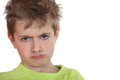 Angry little boy is sulking Stock Photo