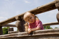 Angry little girl on the playground blonde Royalty Free Stock Photography