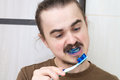 Angry man about the april joke by colouring his tooth brush Royalty Free Stock Image