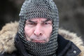 Angry man in armor portrait of outdoor winter Royalty Free Stock Photo