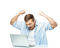 Angry man behind laptop stylish young Stock Photography