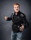 Angry man with a blade in his hands Royalty Free Stock Photo