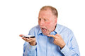 Angry man on cell phone closeup portrait mad senior mature business worker pissed off employee shouting while isolated white Stock Photo