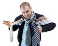 Angry man choosing the perfect necktie Royalty Free Stock Photography