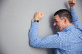 Angry man hitting wall shouting and gray Royalty Free Stock Photography