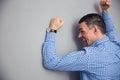 Angry man hitting wall shouting and gray Royalty Free Stock Photography