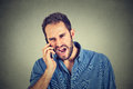Angry man, mad worker, pissed off employee shouting while on phone Royalty Free Stock Photo