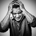 Angry man in pain grunge black and white image of an Stock Photography