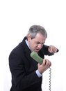 Angry man on the phone an shouting isolated white Royalty Free Stock Images