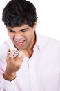 Angry man shouting while on phone closeup portrait of isolated white background with copy space Royalty Free Stock Image