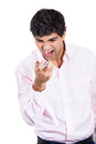 Angry man shouting while on phone closeup portrait of isolated white background with copy space Royalty Free Stock Photography