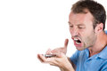 Angry man shouting while on phone closeup portrait of isolated white background with copy space to left Stock Photos