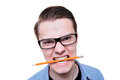 Angry man student with strong teeth eating pencil Stock Photo