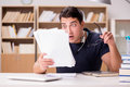 The angry man with too much paperwork to do Royalty Free Stock Photo