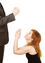 Angry man and woman begging a pardon isolated on white Royalty Free Stock Images