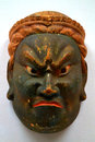 Angry mask a sculpture of an asian warrior Royalty Free Stock Photos