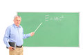 An angry mature teacher and chalkboard Royalty Free Stock Image