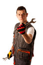 Angry mechanic threats with wrench isolated over white Stock Photos