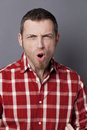 Angry middle age man losing his temper for unhappiness closeup portrait of shouting s wearing casual shirt screaming anger and Stock Photo