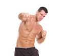 Angry muscular sports man punching Royalty Free Stock Photography