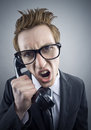 Angry nerd businessman retro telephone call shouting Royalty Free Stock Photography