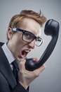 Angry nerd businessman retro telephone call shouting Stock Photography