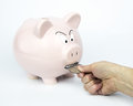 Angry piggy bank the piggybank is there trying to get you to save and protect your savings it will guard every dollar piggybank Stock Photo