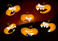 Angry pumpkins six funny cartoon characters with teeth original typical halloween illustration on a dark black background Stock Photo