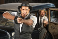 Angry s era gangsters with guns vintage at car weapons Stock Photos