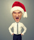 Angry santa man with big head over grey background Royalty Free Stock Photography
