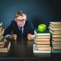 Angry schoolboy in stress or depression at school classroom Royalty Free Stock Photo