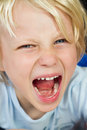 Angry screaming child close up portrait of a very having a tantrum Stock Images