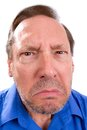 Angry senior adult face of man with parkinsons disease as he stares with a threatening look Royalty Free Stock Photo