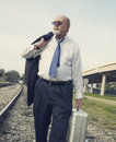 Angry senior businessman walking along railroad track Stock Photography