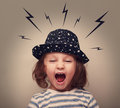 Angry shouting kid with lightnings above Royalty Free Stock Photo