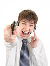 Angry teenager with headset and gun isolated on the white background Royalty Free Stock Image