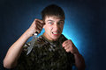 Angry teenager with knife on the dark background Royalty Free Stock Image