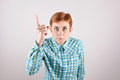 Angry threatening woman with a raised index finger Stock Photos
