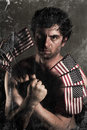 Angry uncle sam stylized fighter holding american flags as claws Royalty Free Stock Images