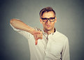Angry, unhappy man showing thumbs down sign Royalty Free Stock Photo