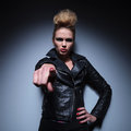 Angry woman accusing you by pointing finger fashion in leather jacket is her Stock Images