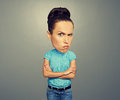 Angry woman with big head looking at camera over dark background Royalty Free Stock Image