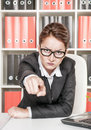 Angry woman boss pointing out at someone Stock Image
