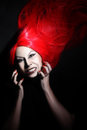 Angry woman expressive anger model in red hair wig isolated on black Royalty Free Stock Image