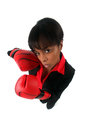 Angry woman with her punching gloves Stock Photography