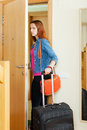 Angry woman leaves home with suitcase because divorce Stock Photo