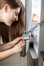 Angry woman opening chain on refrigerator with key adult Royalty Free Stock Image