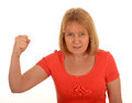 Angry woman with raised fist portrait of an a white studio background Royalty Free Stock Photo