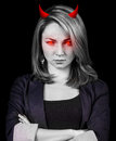 Angry woman with red eyes and devil horns Royalty Free Stock Photo