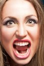 Angry woman screaming beautiful agry blonde close up photo Stock Image